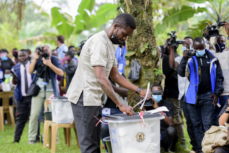 Uganda's leading opposition challenger Bobi Wine casts his vote in Kampala, Uganda, Thursday, Jan. 14, 2021. Ugandans are voting in a presidential election tainted by widespread violence that some fear could escalate as security forces try to stop supporters of Wine from monitoring polling stations.(AP Photo/Nicholas Bamulanzeki)