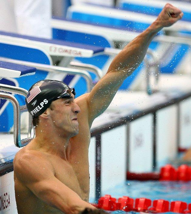 Michael Phelps of the United States celebrates victory in the Men's 100m Butterfly Final held at the National Aquatics Centre during Day 8 of the Beijing 2008 Olympic Games on August 16, 2008 in Beijing, China. By winning gold in the Men's 100m Butterfly Phelps tied Mark Spitz's record of winning seven gold medals in a single Olympic Games. (Getty Images)