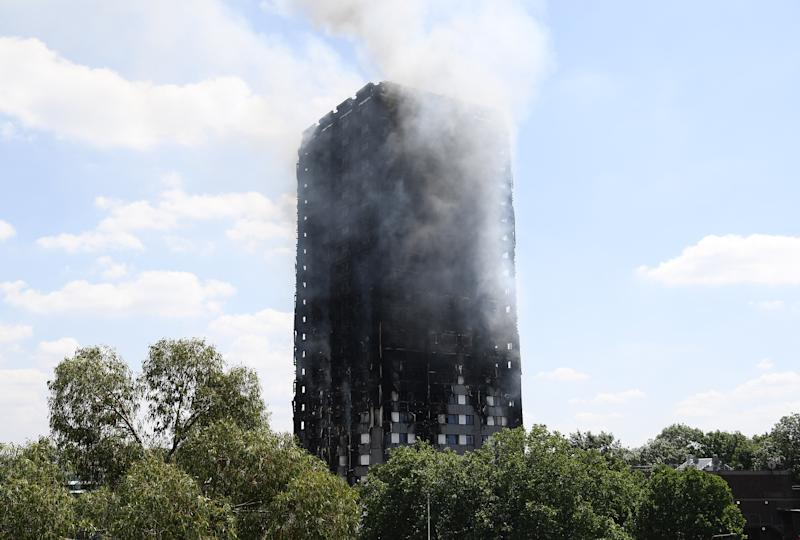 LONDON, ENGLAND - JUNE 14: Smoke continues to rise from the burning 24 storey residential Grenfell Tower block in Latimer Road, West London on June 14, 2017 in London, England. The Mayor of London, Sadiq Khan, has declared the fire a major incident as more than 200 firefighters are still tackling the blaze, while at least 50 people are receiving hospital treatment. (Photo by Carl Court/Getty Images)
