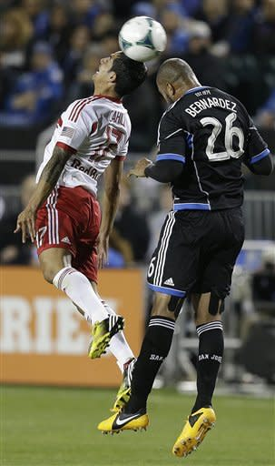 New York Red Bulls' Tim Cahill, left, and San Jose Earthquakes' Victor Bernardez (26) fight for the ball during the first half of an MLS soccer game Sunday, March 10, 2013, in Santa Clara, Calif. (AP Photo/Ben Margot)