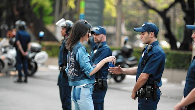 Kendall Jenner starred in a Pepsi ad that appeared to borrow imagery from the Black Lives Matter movement. (Photo: Pepsi)