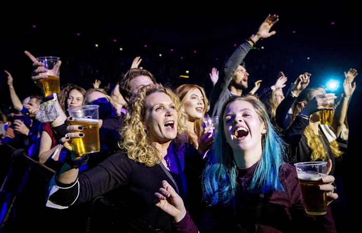 Visitors to the Ziggo Dome attend a performance by Dutch singer Andre Hazes  in Amsterdam on March 7 2021 during a series of trial events in which Fieldlab is investigating how large events can take place safely. (Koen Van Weel / ANP/AFP via Getty Images)