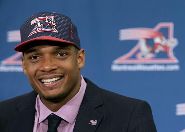 Newly signed defensive end Michael Sam smiles as he is introduced to the media by the Montreal Alouettes CFL football team in Montreal in this May 26, 2015 file photo. Michael Sam, who last year became the first openly gay player drafted by a National Football League team, said on August 14, 2015 he was stepping away from football, citing concerns over his mental health. REUTERS/Christinne Muschi/Files
