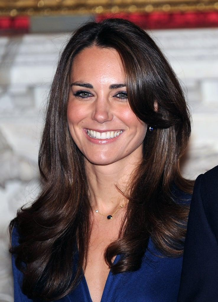 <p>For Kate Middleton and Prince William's official engagement announcement photos, she kept her hair sleek and simple with the ends curled away from her face. </p>