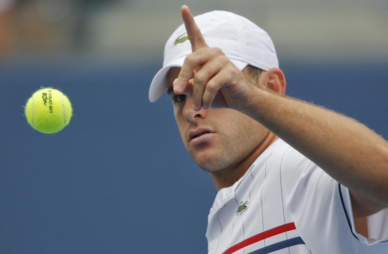 Andy Roddick gestures for another ball to serve to Italy's Fabio Fognini in the third round of play at the 2012 US Open tennis tournament, Sunday, Sept. 2, 2012, in New York. (AP Photo/Mel C. Evans)