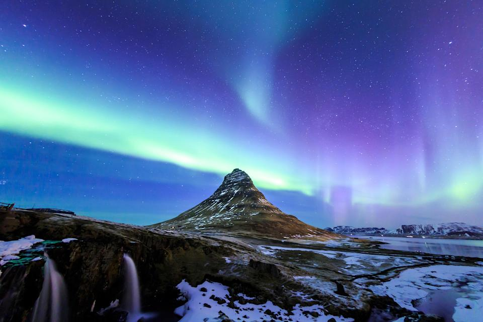 """Aside from being among the most photographed places in Iceland, Kirkjufell is one of the best spots in the country to view the Northern Lights. (And before you ask: Yes, that is Arrowhead Mountain from <a href=""""https://www.cntraveler.com/gallery/game-of-thrones-filming-locations?mbid=synd_yahoo_rss"""" rel=""""nofollow noopener"""" target=""""_blank"""" data-ylk=""""slk:Game of Thrones"""" class=""""link rapid-noclick-resp""""><em>Game of Thrones</em></a>.)"""