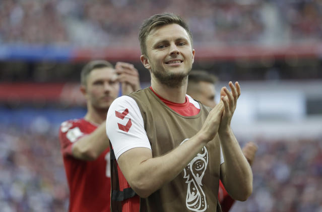Denmark's William Kvist celebrates in front of his teams fans after the end of the group C match between Denmark and France at the 2018 soccer World Cup at the Luzhniki Stadium in Moscow, Russia, Tuesday, June 26, 2018.The match ended 0-0. (AP Photo/Matthias Schrader)