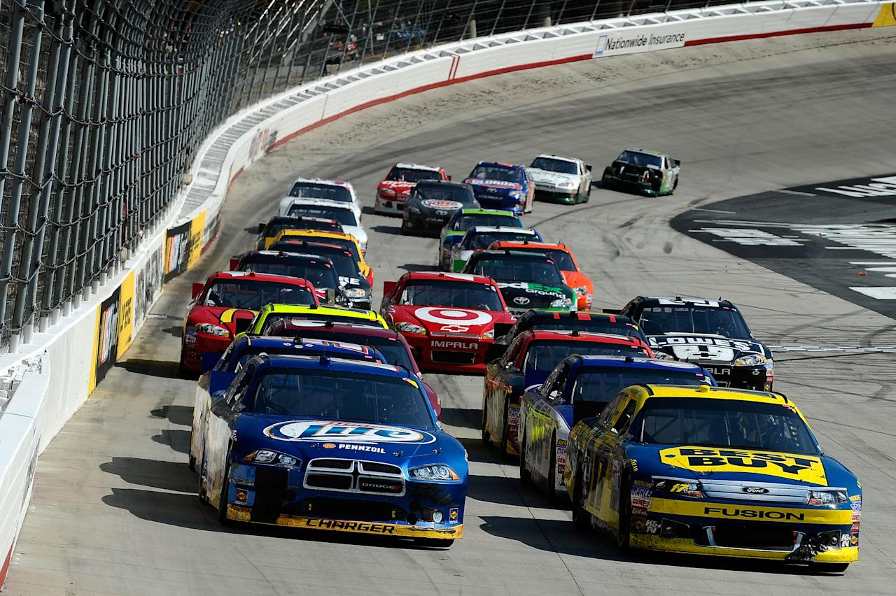 BRISTOL, TN - MARCH 18:  Brad Keselowski, driver of the #2 Miller Lite Dodge, and Matt Kenseth, driver of the #17 Best Buy Ford, lead the field to a restart during the NASCAR Sprint Cup Series Food City 500 at Bristol Motor Speedway on March 18, 2012 in Bristol, Tennessee.  (Photo by Jared C. Tilton/Getty Images)