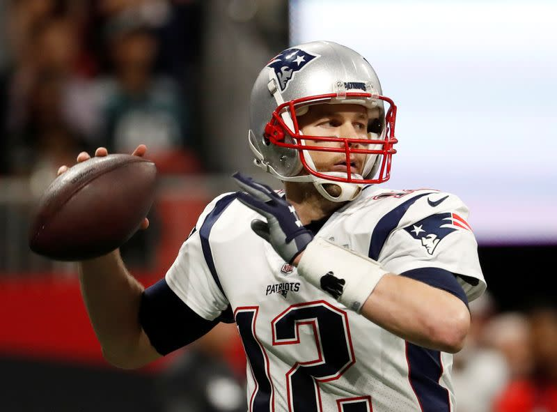 Brady reports to Buccaneers for COVID testing