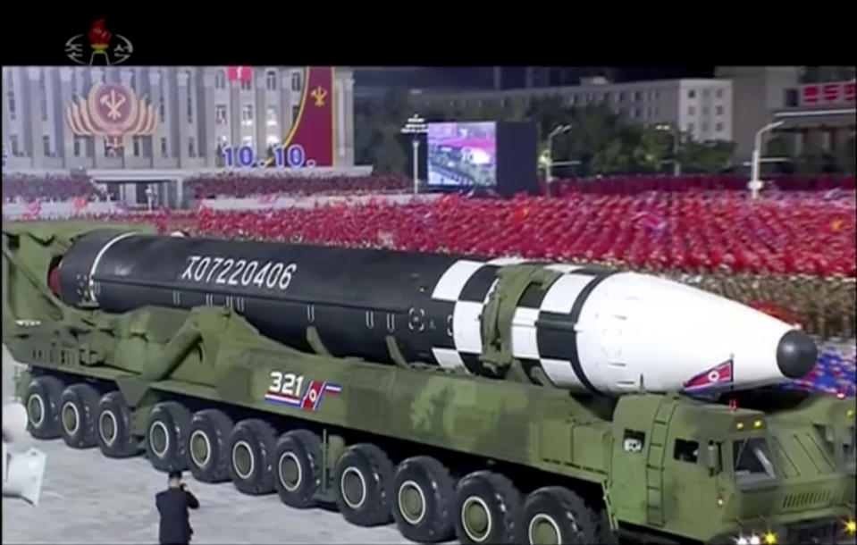 """This image made from video broadcasted by North Korea's KRT, shows a military parade with what appears to be possible new intercontinental ballistic missile at the Kim Il Sung Square in Pyongyang, Saturday, Oct. 10, 2020. North Korean leader Kim Jong Un warned Saturday that his country would """"fully mobilize"""" its nuclear force if threatened as he took center stage at a massive military parade to mark the 75th anniversary of the country's ruling party. (KRT via AP)"""