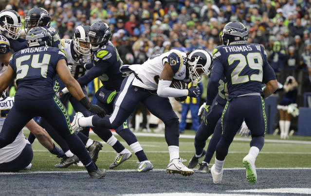 Los Angeles Rams running back Todd Gurley, center, had a career-high four touchdowns against the Seattle Seahawks defense. (AP)