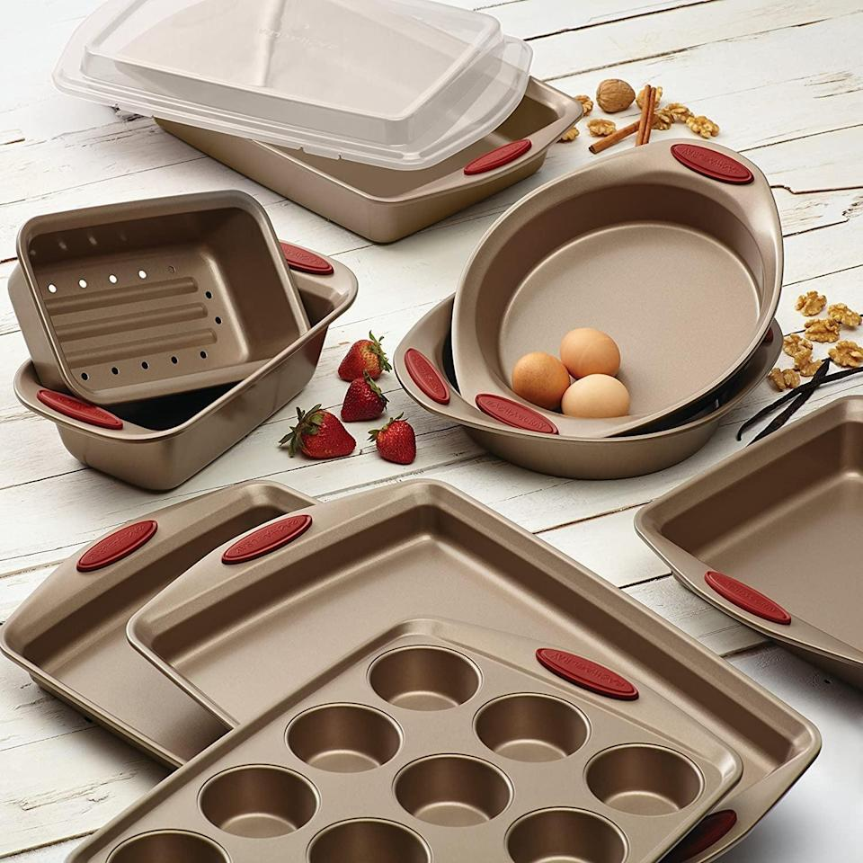 <p>If you're shopping for someone who loves to bake, get them this all-inclusive 10-piece <span>Rachael Ray Cucina Nonstick Bakeware Set</span> ($70, originally $100). It includes two cookie pans, two round cake pans, one square cake pan, two loaf pans, one rectangular cake pan with lid, plus a 12-cup muffin and cupcake pan.</p>
