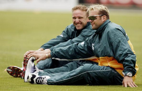 14 Jan 2002:  Jacques Kallis stretches with Allan Donald looking on, during South Africa Training at Bellerive Oval, Hobart, Australia. DIGITAL IMAGE. Mandatory Credit: Hamish Blair/Getty Images