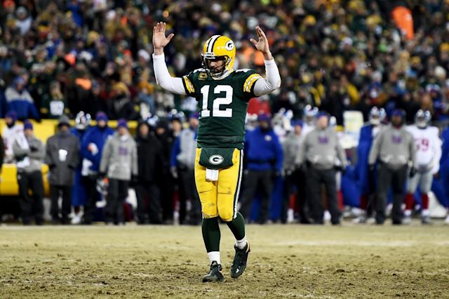 "<a class=""link rapid-noclick-resp"" href=""/nfl/players/7200/"" data-ylk=""slk:Aaron Rodgers"">Aaron Rodgers</a> celebrating yet another touchdown pass. He led the league in TD tosses in 2016, then roasted every defense he saw in the postseason, too. (Photo by Stacy Revere/Getty Images)"