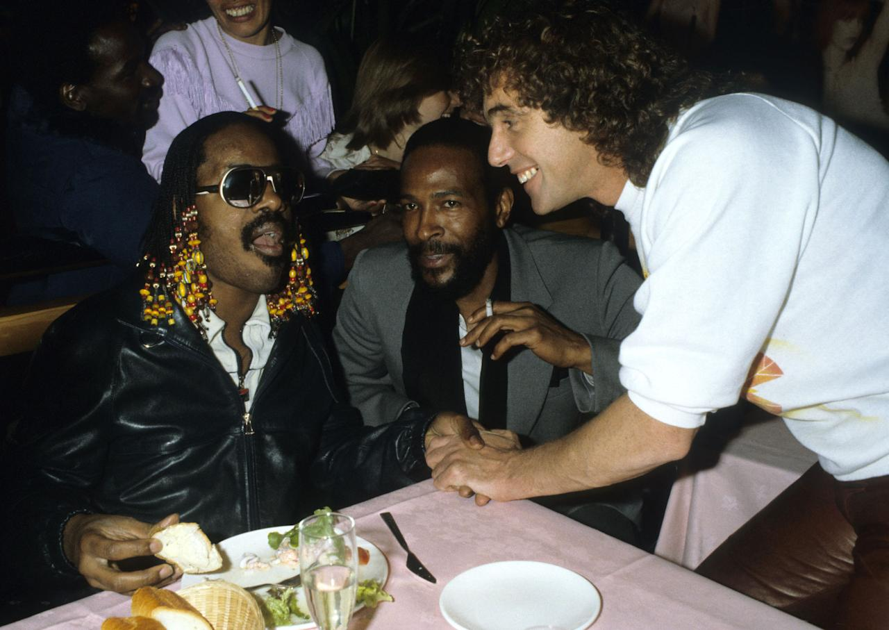 <p>Stringfellow with Stevie Wonder and Marvin Gaye at his nightclub in June 1981. (Rex) </p>