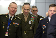 U.S. Marine Lieutenant General and Military Representative John K. Love, center, speaks with Ukraine Military Representative and Lieutenant General Volodymyr Askarov, left, prior to a meeting at NATO headquarters in Brussels, Thursday, Feb. 13, 2020. NATO ministers, in a second day of meetings, will discuss building stability in the Middle East, the Alliance's support for Afghanistan and challenges posed by Russia's missile systems. (AP Photo/Virginia Mayo, Pool)