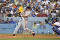 San Francisco Giants' LaMonte Wade Jr, left, hits a solo home run as Los Angeles Dodgers catcher Austin Barnes watches during the third inning of a baseball game Tuesday, July 20, 2021, in Los Angeles. (AP Photo/Mark J. Terrill)