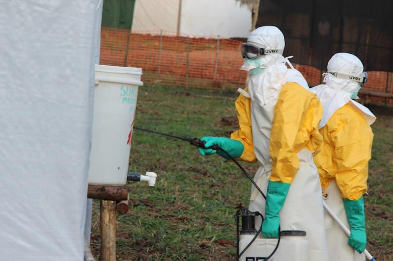 Hygienists wearing protective suits disinfect the toilets of an Ebola treatment centre in DR Congo during an earlier outbreak (AFP Photo/KATHY KATAYI)