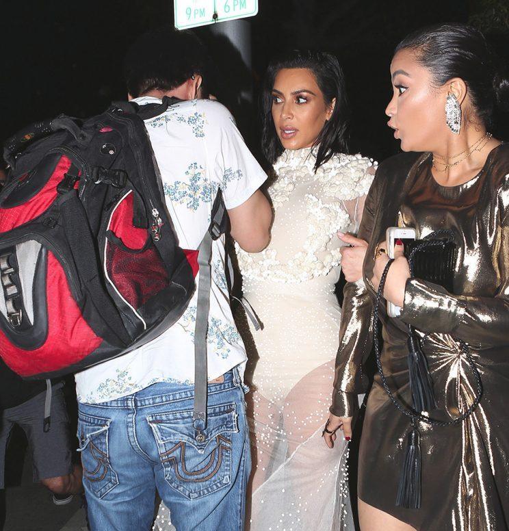 A fan gets too close to Kim for comfort