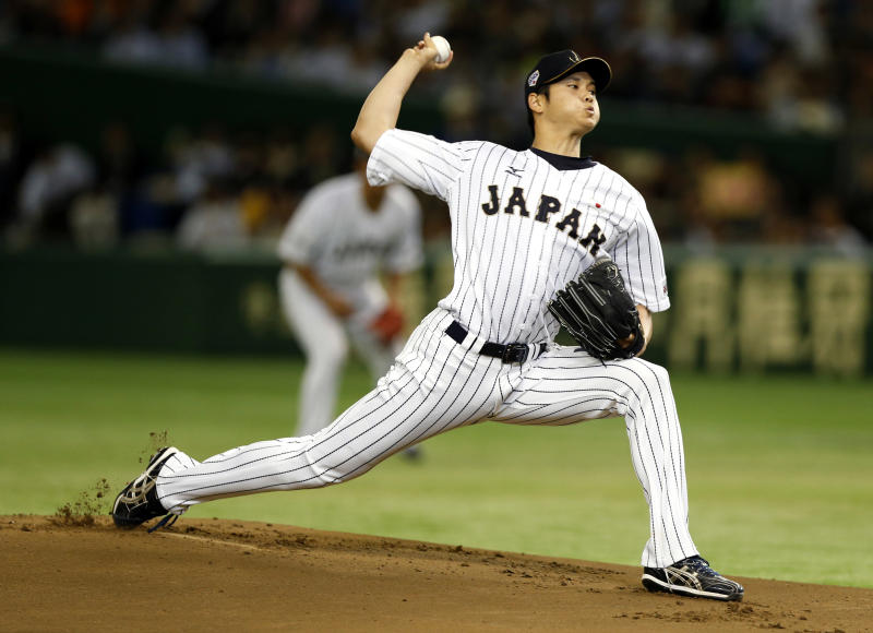 Japan's starter Shohei Otani pitches against South Korea during the first inning of their semifinal game at the Premier12 world baseball tournament at Tokyo Dome in Tokyo. A person familiar with the decision says