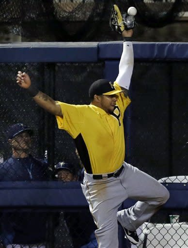Pittsburgh Pirates right fielder Jose Tabata leaps but cannot make the catch on a fly ball which drops into the bullpen for a two-run homer by Tampa Bay Rays' Ben Zobrist in the fifth inning of an exhibition spring training baseball game in Port Charlotte, Fla., Monday, March 25, 2013. (AP Photo/Elise Amendola)