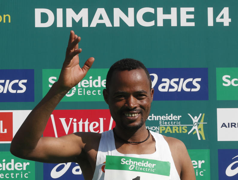 Abrha Milaw of Ethiopia celebrates after he won the man's Paris Marathon with a time of 2 hours 7 minutes and 5 seconds in Paris, France, Sunday, April 14, 2019. (AP Photo/Thibault Camus)