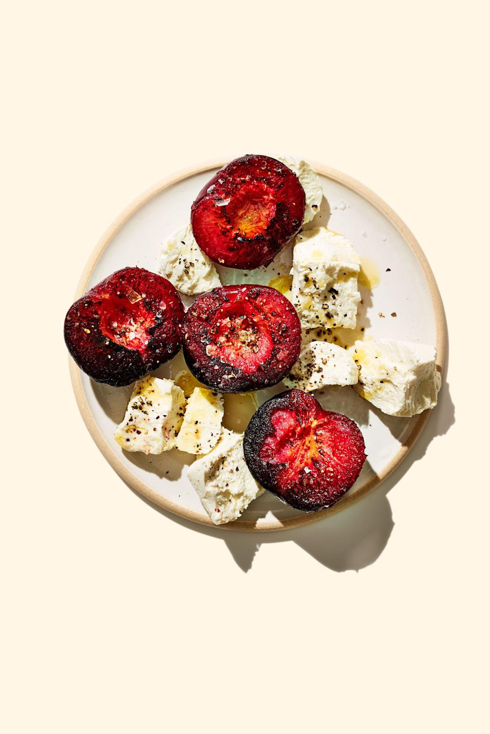 "Plums are summer's all-stars. You should eat and cook with them only when they are peaking, plentiful, and widely available in many varieties. <a href=""https://www.bonappetit.com/recipe/charred-buttered-plums-with-cheese?mbid=synd_yahoo_rss"" rel=""nofollow noopener"" target=""_blank"" data-ylk=""slk:See recipe."" class=""link rapid-noclick-resp"">See recipe.</a>"