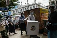 Myanmar's election officials carried mobile ballot boxes around streets of Yangon to make voting more accessible for the vulnerable population