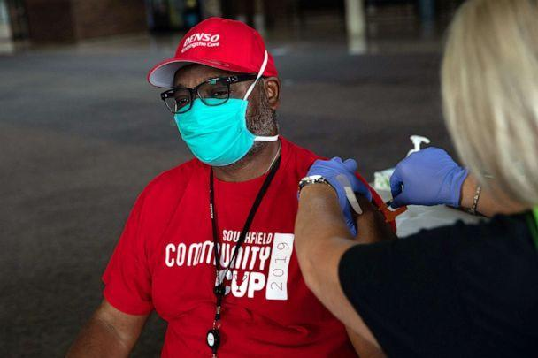 PHOTO: A man receives his booster dose of the COVID-19 vaccine during an Oakland County Health Department vaccination clinic at the Southfield Pavilion on Aug. 24, 2021, in Southfield, Mich. (Emily Elconin/Getty Images, FILE)