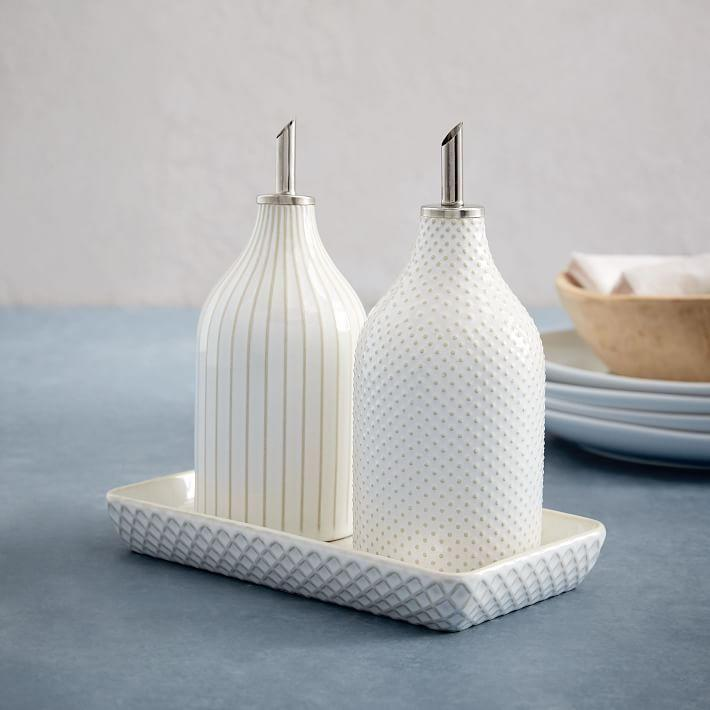 """<p>Opaque stoneware bottles ensure that no natural elements — like the sun or heat from your stovetop — affect the quality of what's inside them.</p><p><strong><em>BUY IT NOW: Textured Oil And Vinegar Set, $39; </em></strong><a href=""""https://www.westelm.com/products/textured-oilvinegar-set-e1470/?pkey=e%7Coil%2Band%2Bvinegar%7C20%7Cbest%7C0%7C1%7C24%7C%7C3&cm_src=PRODUCTSEARCH"""" rel=""""nofollow noopener"""" target=""""_blank"""" data-ylk=""""slk:Westelm.com"""" class=""""link rapid-noclick-resp""""><strong><em>Westelm.com</em></strong></a></p>"""