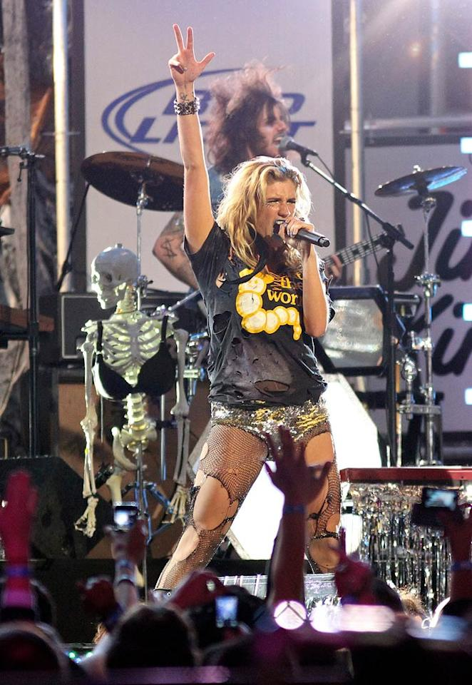 """Ke$ha rocked """"Jimmy Kimmel Live's"""" outdoor stage in Hollywood on Monday night wearing ripped fishnets, sequined panties, and her signature blue lipstick. Also joining Ke$ha onstage? Her skeleton friend, who sported a bra for the occasion. Jean Baptiste Lacroix/<a href=""""http://www.wireimage.com"""" target=""""new"""">WireImage.com</a> - November 22, 2010"""