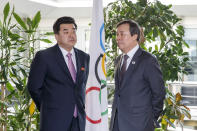 """FILE - In this Feb. 15, 2019, file photo, North Korea's Olympic Committee President and Sports Minister Kim Il Guk, left, and South Korean Sports Minister Do Jong-hwan attend a meeting with the IOC for their bid to co-host the 2032 Summer Olympics, at the IOC Headquarters in Lausanne, Switzerland. North Korea has decided not to participate in this year's Olympic Games in Tokyo as it continues a self-imposed lockdown amid the coronavirus pandemic. A website run by the North's Sports Ministry said the decision was made during a national Olympic Committee meeting on March 25, 2021 where members prioritized protecting athletes from the """"world public health crisis caused by COVID-19."""" (Salvatore Di Nolfi/Keystone via AP, File)"""