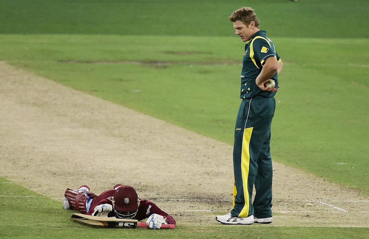 ]MELBOURNE, AUSTRALIA - FEBRUARY 10:  Devon Thomas of the West Indies lies on the ground after he was run out by James Faulkner of Australia during game five of the Commonwealth Bank International Series between Australia and the West Indies at Melbourne Cricket Ground on February 10, 2013 in Melbourne, Australia.  (Photo by Michael Dodge/Getty Images)