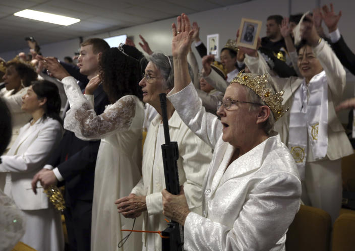 <p>A woman wears a crown and holds an unloaded weapon during services at the World Peace and Unification Sanctuary, Wednesday Feb. 28, 2018 in Newfoundland, Pa. (Photo: Jacqueline Larma/AP) </p>