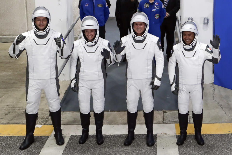 The Crew Dragon space capsule astronauts, from front left, European Space Agency astronaut Thomas Pesquet, NASA astronaut Megan McArthur, NASA astronaut Shane Kimbrough and Japan Aerospace Exploration Agency astronaut Akihiko Hoshide leave the Operation and Checkout Building on their way to board the capsule for a mission to the International Space Station at the Kennedy Space Center in Cape Canaveral, Fla., Friday, April 23, 2021. (AP Photo/John Raoux)