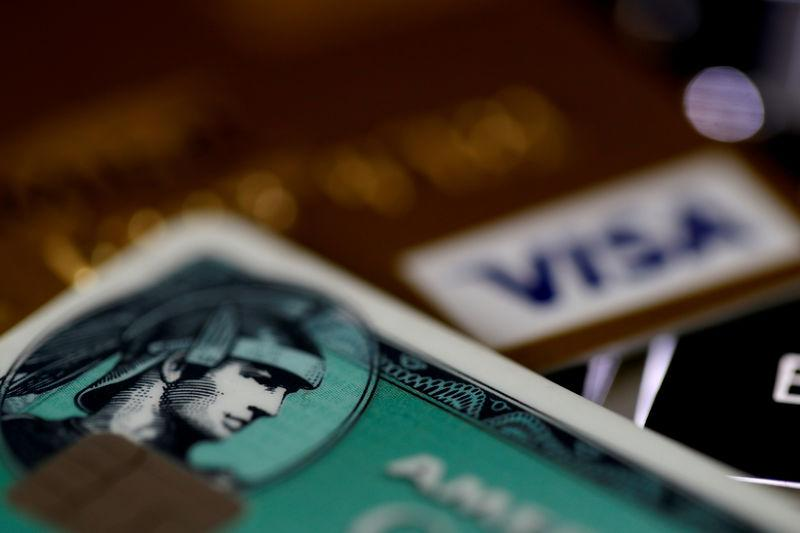 FILE PHOTO: An American Express and a Visa credit cards are seen on a computer keyboard in this picture illustration