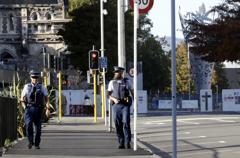 Police patrol the near empty streets of the central business district in Christchurch, New Zealand, on the first day of lockdown. Source: AAP