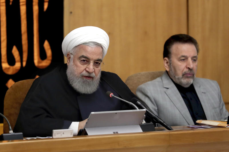 "In this photo released by the office of the Iranian Presidency, President Hassan Rouhani speaks in a cabinet meeting in Tehran, Iran, Wednesday, Sept. 4, 2019. Rouhani reiterated a threat that Tehran would take additional steps away from the 2015 nuclear accord on Friday and accelerate its nuclear activities if Europe fails to provide a solution, calling it Iran's third, ""most important step"" away from the deal. (Iranian Presidency Office via AP)"