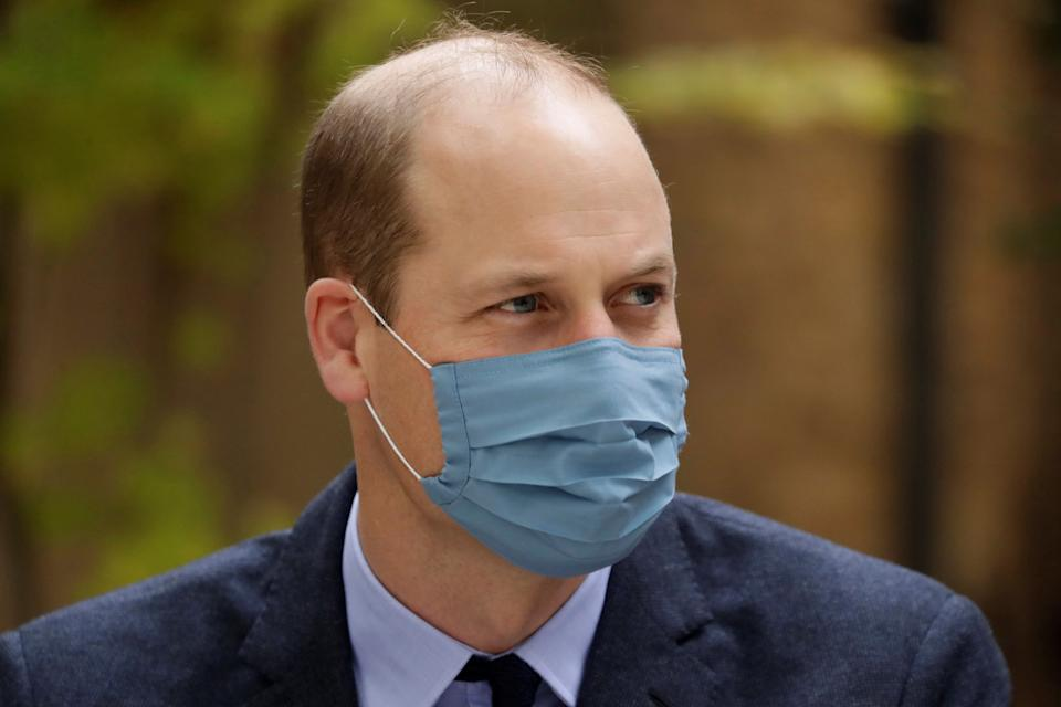 Britain's Prince William, Duke of Cambridge wears a face mask as he visits St. Bartholomew's Hospital in London, to mark the launch of the nationwide 'Hold Still' community photography project on October 20, 2020.