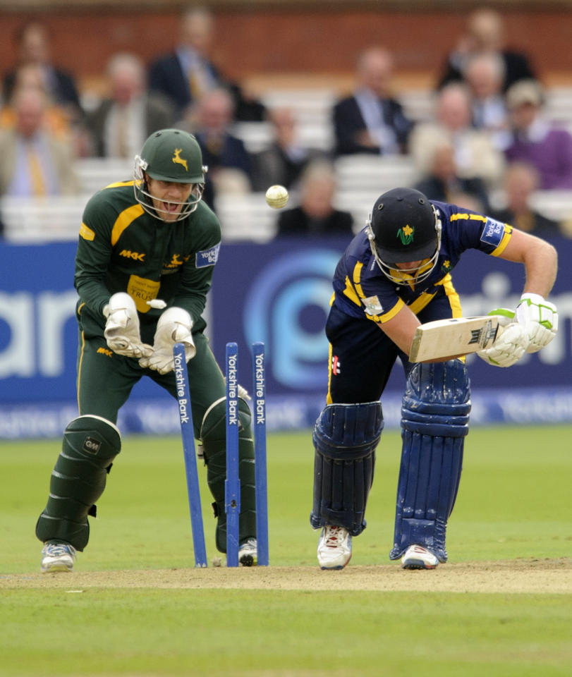 Nottinghamshire's Samit Patel takes the wicket of Glamorgan's Chris Cooke as Chris Read watches on during the Yorkshire Bank Pro40 Final at Lord's Cricket Ground, London.