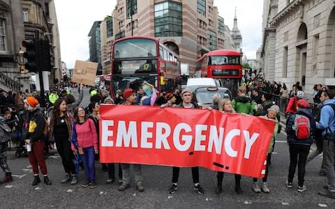 Climate protesters block City of London around the Bank of England - Credit: Gavin Rodgers