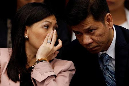 Maia Santos Deguito, a branch manager of the Rizal Commercial Banking Corp (RCBC) whispers to her lawyer as she testifies during a Senate hearing on the money laundering involving $81 million stolen from Bangladesh central bank, at the Philippine Senate in Manila April 12, 2016.   REUTERS/Erik De Castro/File Photo