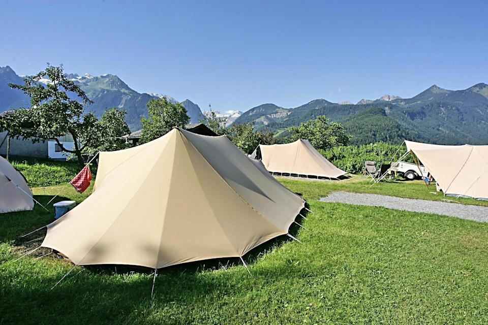 """<p><span>Sonnenberg translates as """"sunny mountains"""", and </span><a href=""""https://coolcamping.com/campsites/europe/austria/1850-panorama-camping-sonnenberg"""" rel=""""nofollow noopener"""" target=""""_blank"""" data-ylk=""""slk:this traditional campsite"""" class=""""link rapid-noclick-resp""""><span>this traditional campsite</span></a><span> is ringed by magnificent peaks, with a host of facilities including washing and drying rooms, internet and a library. A tent and two people from €14.40 (£12). [Photo: Cool Camping]</span> </p>"""
