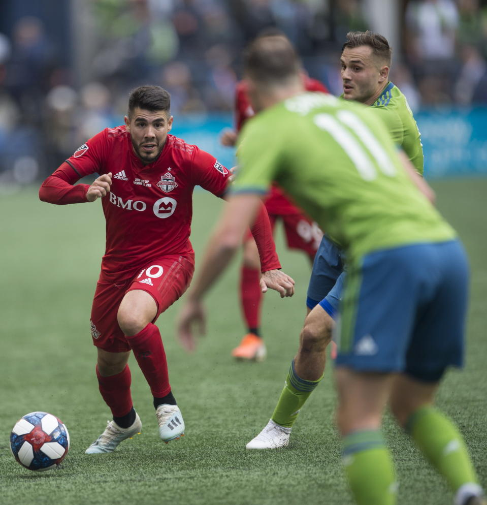 Toronto FC midfielder Alejandro Pozuelo (10) tries to get past Seattle Sounders defender Brad Smith (11) during the first half of the MLS Cup soccer match in Seattle on Sunday, Nov. 10, 2019. (Jonathan Hayward/The Canadian Press via AP)