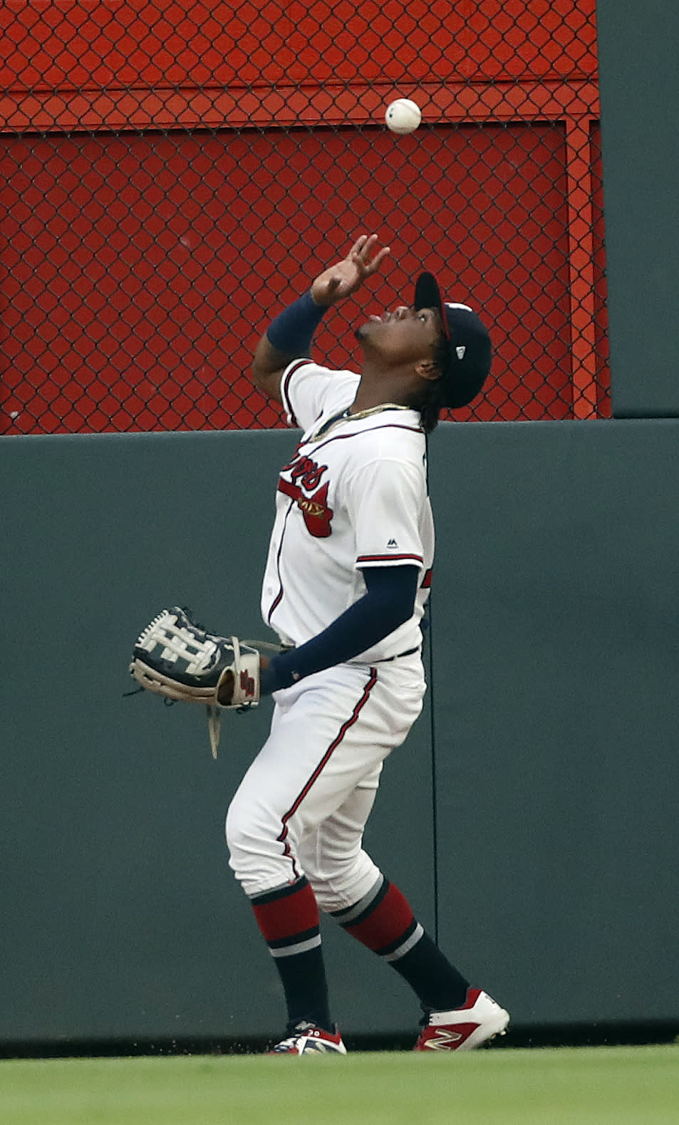 Atlanta Braves center fielder Ronald Acuna Jr. (13) bare hands a ball hit for double by New York Mets' Jeff McNeil in the third inning of a baseball game Tuesday, June 18, 2019, in Atlanta. (AP Photo/John Bazemore)