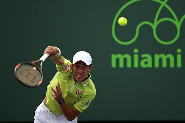 Kei Nishikori of Japan plays a match against Mikhail Youzhny of Russia during Day 6 of the Miami Open on March 28, 2015 in Key Biscayne, Florida (AFP Photo/Mike Ehrmann)