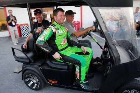 Dale Earnhardt Jr. gets a ride back to his team after speaking with reporters following his last race at Talladega before his impending retirement, after fading to a seventh-place finish in NASCAR's Alabama 500 at Talladega Superspeedway in Lincoln, Alabama, U.S. October 15, 2017. REUTERS/Jonathan Ernst