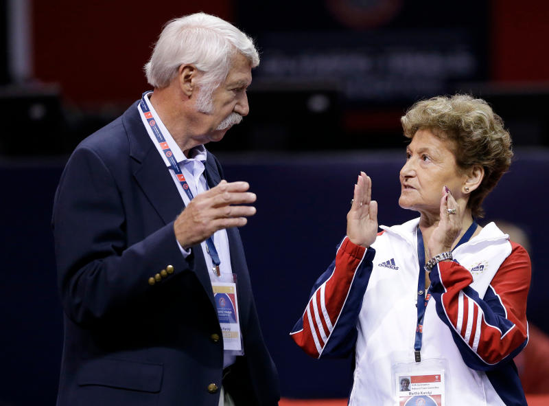 "FILE - In this June 29, 2012, file photo, Bela, left, and Martha Karolyi talk on the arena floor before the start of the preliminary round of the women's Olympic gymnastics trials in San Jose, Calif. Former USA Gymnastics women's national team coordinator Martha Karolyi and her husband Bela tell NBC they were unaware of the abusive behavior by a former national team doctor now serving decades in prison. Martha Karolyi led the national team for 15 years before retiring after the 2016 Rio Olympics. She tells Savannah Guthrie in ""no way"" did she suspect Larry Nassar was sexually abusing athletes. (AP Photo/Gregory Bull, File)"