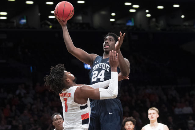 Penn State forward Mike Watkins (24) shoots over Syracuse forward Quincy Guerrier (1) during the second half of an NCAA college basketball game in the consolation round of the NIT Season Tip-Off tournament, Friday, Nov. 29, 2019, in New York. Penn State won 85-64. (AP Photo/Mary Altaffer)