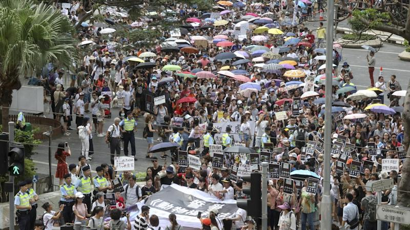 Thousands march for animal rights in Hong Kong with protesters demanding abusers get 10 years behind bars